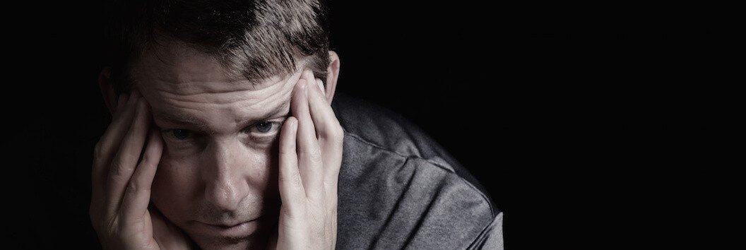 Mature man with headache from bankruptcy stress